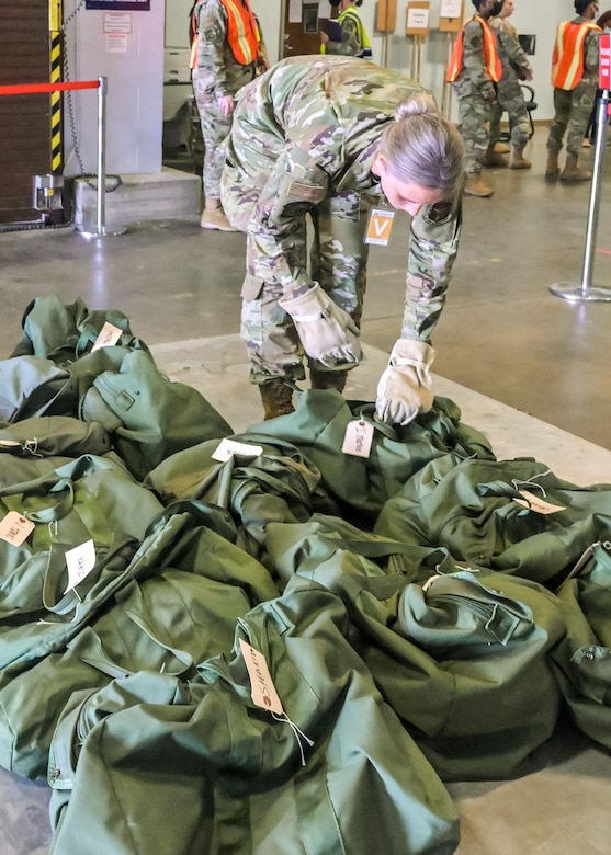U.S. Air Force Reserve Airmen from the 913th Airlift Group prepare equipment to be palletized as part of the phase 1 deployment exercise June 6, 2021, at Little Rock Air Force Base, Arkansas. The event tested predeployment administrative processes and will identify areas of improvement before a real world deployment. (U.S. Air Force photo by Maj. Ashley Walker)