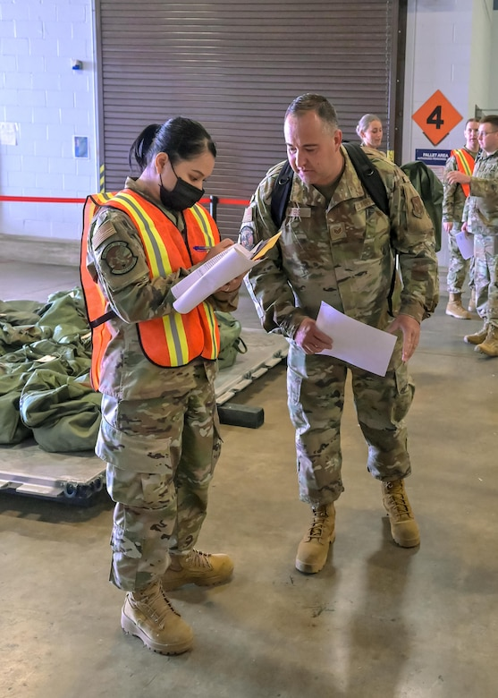 U.S. Air Force Reserve Airmen from the 913th Airlift Group process through the predeployment function line of the phase 1 deployment exercise June 6, 2021, at Little Rock Air Force Base, Arkansas. The event tested predeployment administrative processes and will identify areas of improvement before a real world deployment. (U.S. Air Force photo by Maj. Ashley Walker)