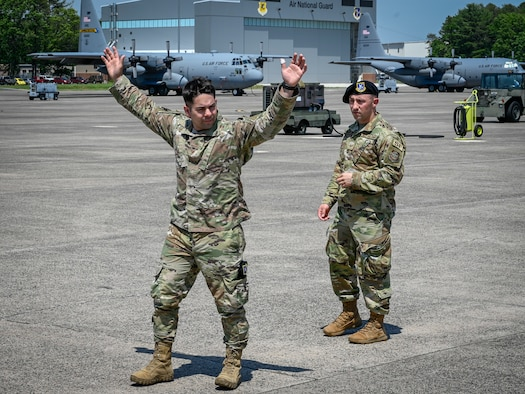 Tech. Sgt. Leo Otero, left, and Staff Sgt. Daniel Vanwormer, 103rd Security Forces Squadron, demonstrate detaining procedures during a training course on flight line security for the 103rd Maintenance Group at Bradley Air National Guard Base, East Granby, Connecticut, June 5, 2021. The course taught maintainers techniques for bolstering security, responding to potential threats before Security Forces personnel arrive.