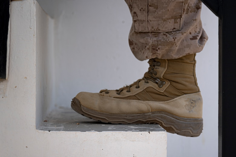 A photo of a Marine climbing stairs