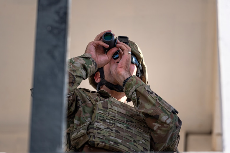 A photo of an Airman looking over a range