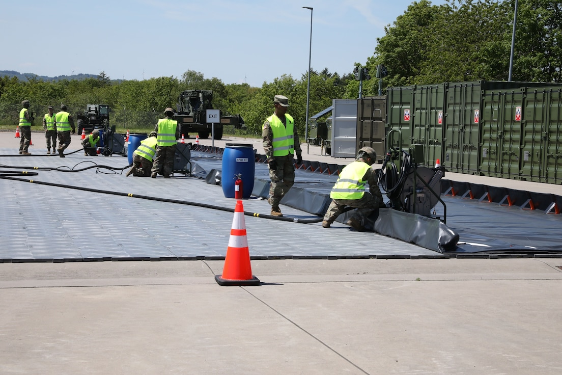 Soldiers from the 1st Inland Cargo Transfer Company, 39th Movement Control Battalion, showcase the new Convoy Support Center kit at Baumholder, Germany, to demonstrate the CSC's capabilities to leadership of the 21st Theater Sustainment Command. The 1st ICTC received 10 CSC kits. These kits consist of fueling system, operations center, traffic control, solar lighting, and flooring.