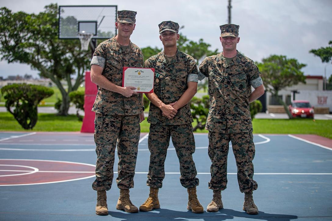 U.S. Marines pose for a group photo on Marine Corps Air Station Futenma, Okinawa, Japan, June 8.