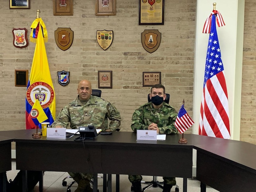 Col. Jeffrey Lopez, left, chief, U.S. Army South Security Cooperation Division, provides opening remarks with Lt. Col. Francisco Candela, right, deputy director, Colombian Army Bilateral Relations, to begin the U.S., Colombian Army Staff Talks at the Army Infantry School in Bogota, Colombia, June 9, 2021.  The U.S. Army Staff Talks Program serves as a bilateral engagement for military discussion between respective armies. This year marks the 12th time the U.S. Army and the Colombian Army have met for staff talks, which has been instrumental in enhancing the interoperability and cooperation between the two partners.