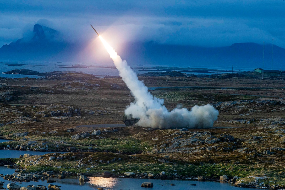A rocket launches into the sky.