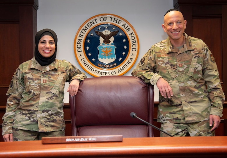 Capt. Maysaa Ouza (left), 88th Air Base Wing chief of adverse actions, and Capt. Yosef Hochheiser, Air Force reservist and 88 ABW assistant staff judge advocate, are pictured in the U.S. courtroom at Wright-Patterson Air Force Base on May 20. Their partnership helped establish the first religious-accommodation rule change for Muslims to wear a hijab in uniform. (US Air Force photo by R.J. Oriez)