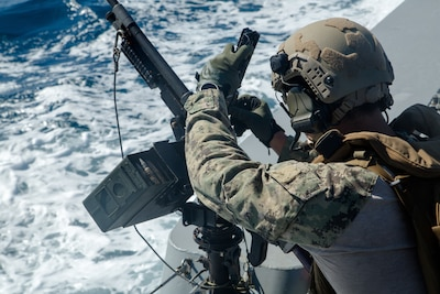 ARABIAN GULF (June 2, 2021) – A Sailor assigned to Commander, Task Force (CTF) 56 participates in a live-fire exercise as part of an air operations in support of maritime surface warfare (AOMSW) exercise in the Arabian Gulf, June 2. CTF 56 commands and controls the employment of tactical Navy expeditionary combat forces in order to maximize U.S. 5th Fleet's lethality throughout the maritime domain utilizing eight task groups whose missions range from explosive ordnance disposal and salvage diving, Army civil affairs, Naval construction forces and expeditionary logistics support, maritime interdiction operations and maritime security, and embarked security teams. (U.S. Army photo by Spc. Zion Thomas)