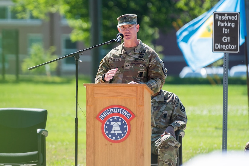 one man in uniform standing at a podium.