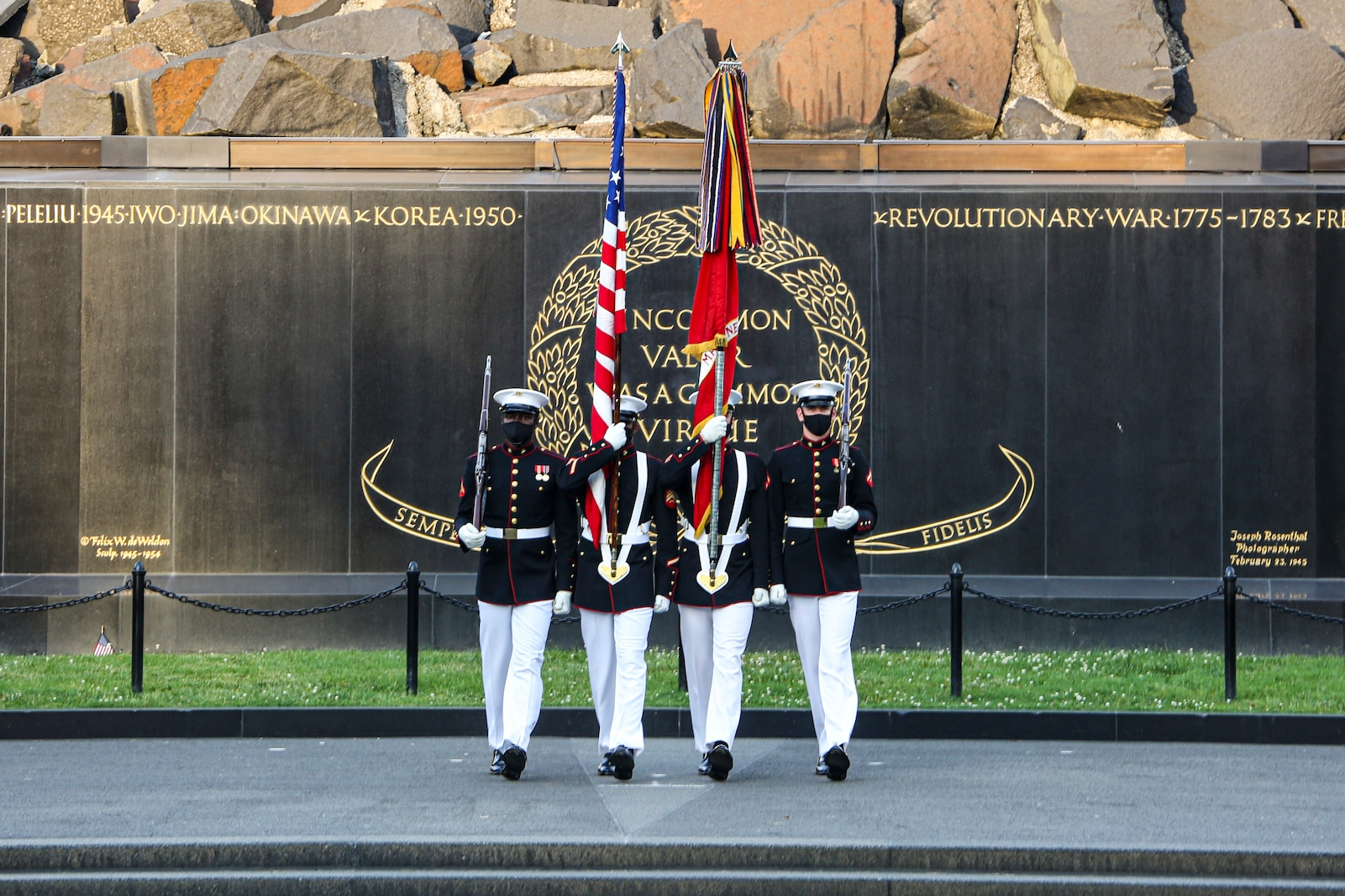Marines with the Official U.S. Marine Corps Color Guard march into position during a Tuesday Sunset Parade at the Marine Corps War Memorial, Arlington, Va., June 8, 2021.