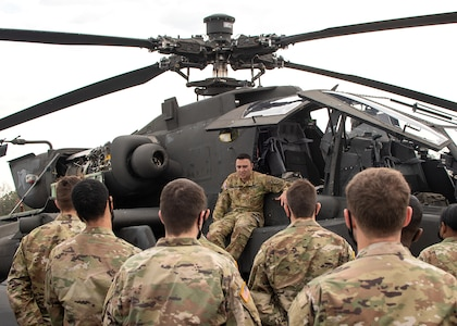 Maj. Eric Juarez, a helicopter pilot with the 449th Combat Aviation Brigade, North Carolina Army National Guard, speaks with ROTC cadets from East Carolina University during an ROTC training event in Greenville, North Carolina. Army National Guard members interested in commissioning through ROTC may also qualify for the Army National Guard ROTC Minuteman Scholarship, a program administered through the U.S. Army Cadet Command that pays full tuition and other education expenses for Army Guard members enrolled in an Army ROTC program.