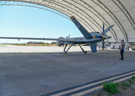Tech. Sgt. James O'Neil, 214th Attack Group crew chief, completes the pre-flight inspection on an MQ-9 Reaper