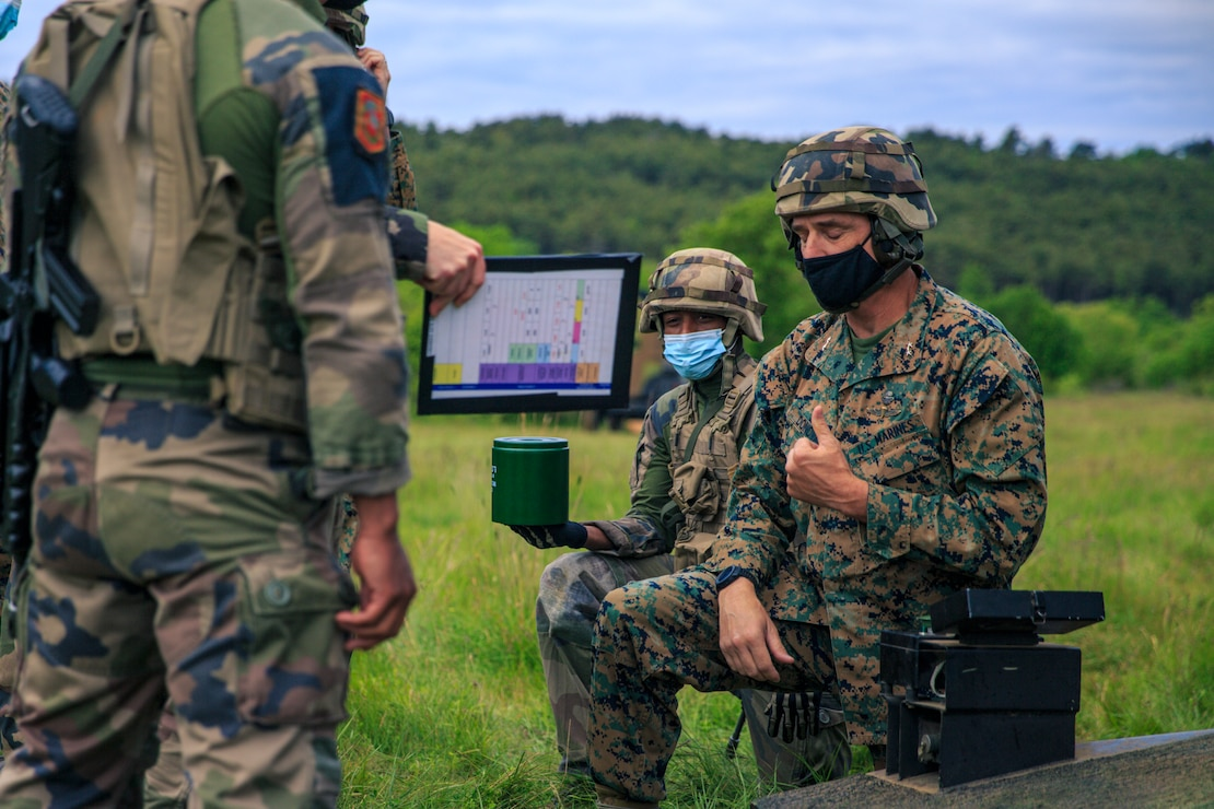 U.S. Marine Corps Maj. Gen. Francis Donovan, commanding general of 2d Marine Division, observes a dynamic display with 3rd Marine Artillery Regiment, 6th Light Armoured Brigade, on Military Camp of Canjuers, France, June 1, 2021. Donovan's visit to France included engagements with key leaders to strengthen relationships with the French Armed Forces in order to refine interoperability for future cooperation. (U.S. Marine Corps photo by Sgt. Margaret Gale)