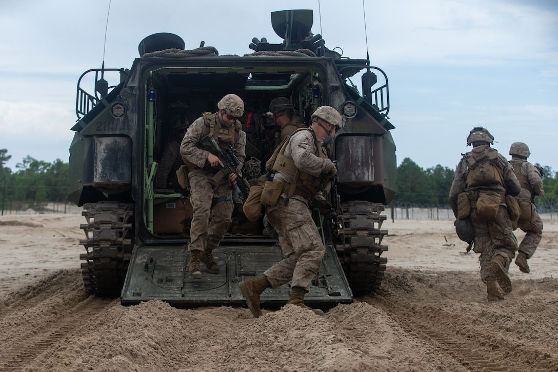 U.S. Marines with 2d Combat Engineer Battalion, 2d Marine Division, exit an amphibious assault vehicle during a demolition range as part of a Marine Corps Combat Readiness Evaluation on Camp Lejeune, N.C., June 7, 2021.