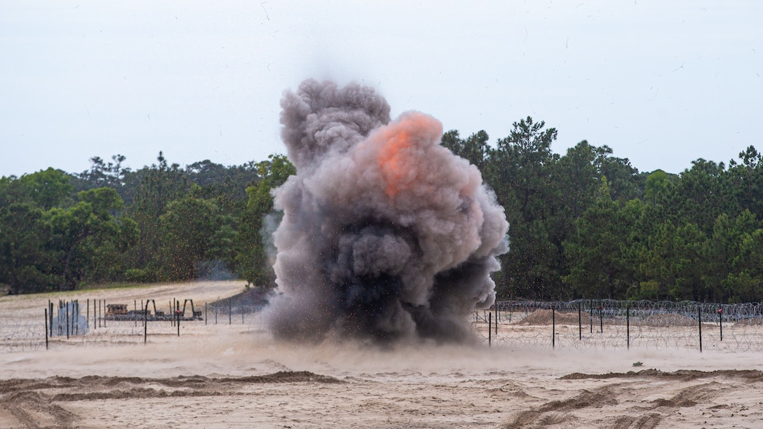 U.S. Marines with 2d Combat Engineer Battalion, 2d Marine Division, breach an obstacle with bangalore torpedoes during a demolition range as part of a Marine Corps Combat Readiness Evaluation on Camp Lejeune, N.C., June 7, 2021.