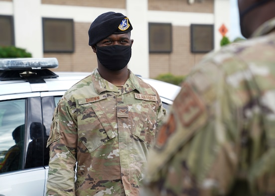 U.S. Air Force Senior Airman Leonard Brown, 81st Security Forces Squadron NCOIC of police services, talks to Airman 1st Class Grady Adams, 81 SFS patrolman, outside the security forces building at Keesler Air Force Base, Mississippi, June 7, 2021. The 81st SFS is responsible for making sure the base populace is safe at all times. (U.S. Air Force photo by Senior Airman Spencer Tobler)