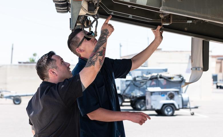 Daniel Villela (left) and Staff Sgt. Daniel Ward, 56th Logistics Readiness Squadron vehicle management technicians, work at the 56th LRS Rapid Maintenance Annex May 17, 2021, at Luke Air Force Base, Arizona.