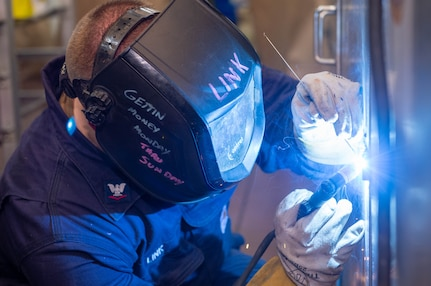 Hull Maintenance Technician 3rd Class Alex Link, from Collinsville, Illinois, welds a cabinet in the bakery aboard the Nimitz-class aircraft carrier USS Harry S. Truman (CVN 75) during Tailored Ship's Training Availability (TSTA) and Final Evaluation Problem (FEP).