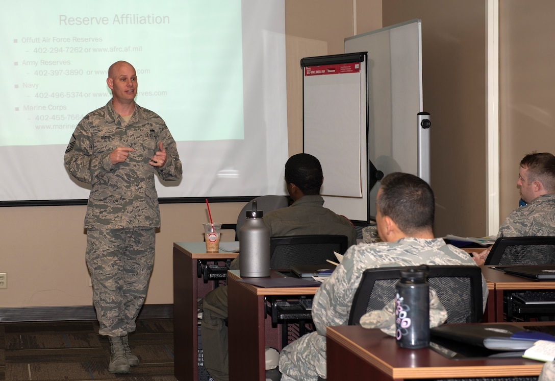 Airmen in front of a classroom speaking to Airmen seated at each desk
