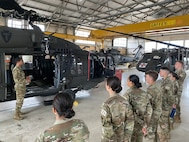 A U.S. Army warrant officer briefs U.S. Air Force Academy cadets about the flight capabilities of a UH-60 Blackhawk helicopter at Martindale Army Airfield, San Antonio, Texas, May 28, 2021.