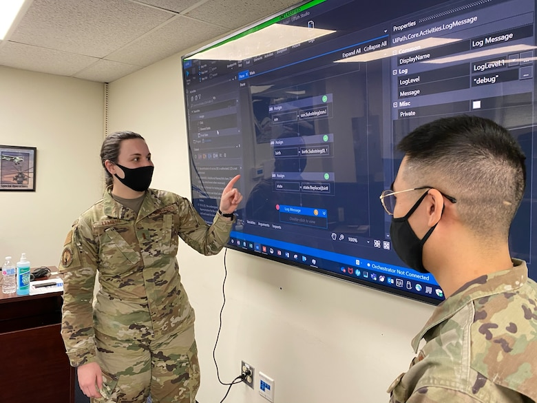 Second Lt. Arianna Lemieux examines UiPath's user interface and data processing steps with 1st Lt. Luke Chen in the collaborative classroom.