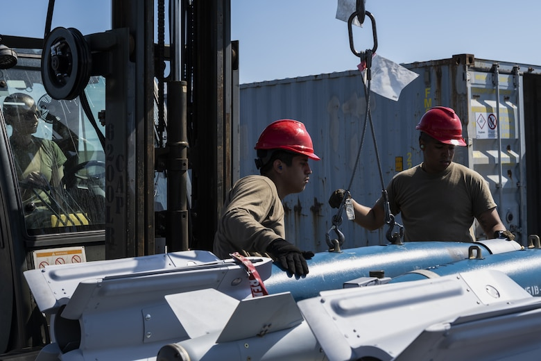 U.S. Air Force Airmen from the 52nd Maintenance Squadron at Spangdahlem Air Base, Germany, load a fully assembled GBU-12 inert bomb used for training at Kallax Air Base, Sweden, June 7, 2021. Airmen working in the ammunitions section of the 52nd MXS play a vital role in assembling ammunition used for the continuous deterrence of enemy forces during exercises such as the Arctic Challenge Exercise 2021. (U.S. Air Force photo by Senior Airman Ali Stewart)