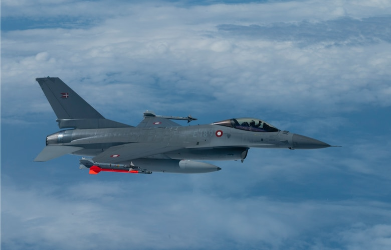 A Danish F-16 integrates with a U.S. B-52H Stratofortress, assigned to the 2nd Bomb Wing, Barksdale Air Force Base, Louisiana, out of Morón Air Base, Spain, in support of Bomber Task Force Europe June 07, 2021.