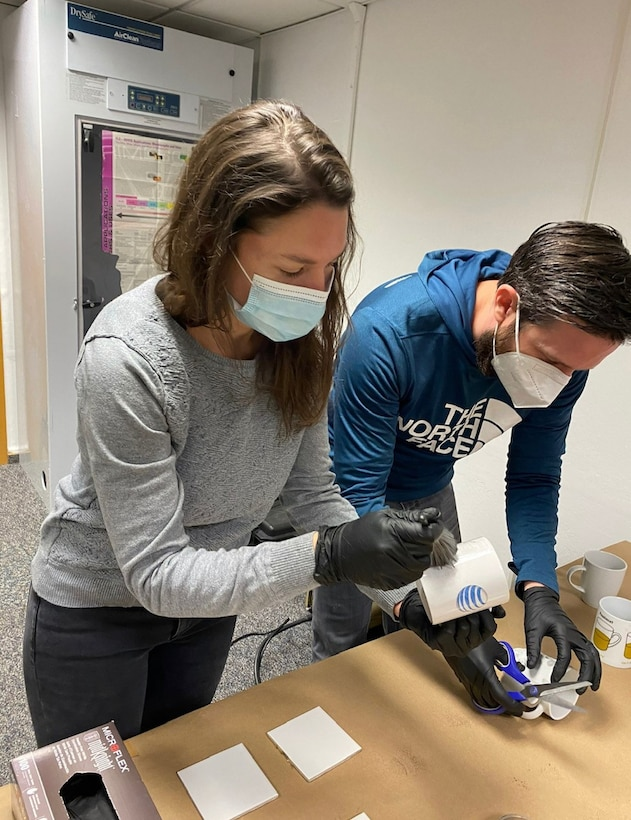 Civilian Leadership Development Program members inspect simulated evidence during an immersion tour with the Air Force Office of Special Investigations Region 5 and 4 Field Investigative Squadron staff at Ramstein Air Base, Germany, May 14, 2021.