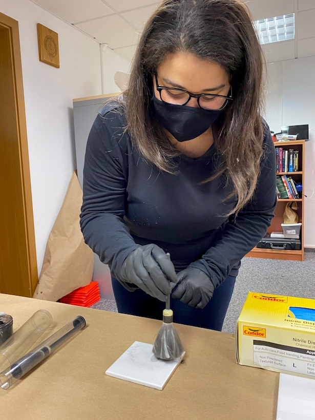 Arianne Gouveia, intelligence specialist with the USAFE-AFAFRICA Directorate of Intelligence, participates in simulated evidence investigation during an Air Force Office of Special Investigations Region 5 and 4 Field Investigative Squadron site visit at Ramstein Air Base, Germany, May 14, 2021.