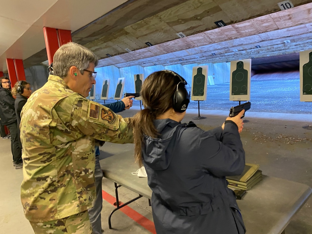 An Air Force Office of Special Investigations Region 5 agent instructs a government civilian, assigned to the U.S. Air Forces in Europe and Air Forces Africa headquarters, in target practice at the firing range on Ramstein Air Base, Germany, May 14, 2021.