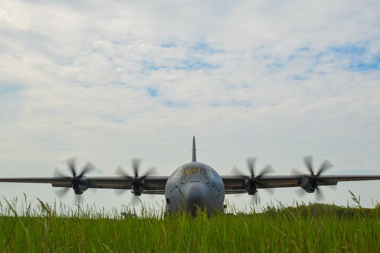 A U. S. Air Force C-130J Super Hercules sits on the flightline