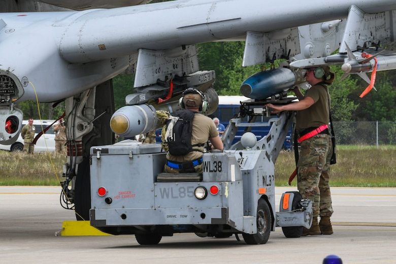Airmen from the 354th Aircraft Maintenance Unit load a munition to a U.S. Air Force A-10 Thunderbolt II