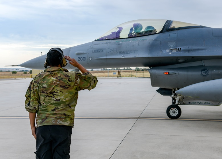 Airman 1st Class Abdiel Hilerio Arvelo, 555th Fighter Squadron F-16 Fighting Falcon crew chief, salutes a U.S. Air Force F-16 pilot during Falcon Strike 21 (FS21) at Amendola Air Base, Italy, June 7, 2021. FS21 is a joint, multinational exercise designed to provide aircrew training through fourth-and-fifth-generation integration. (U.S. Air Force photo by Airman 1st Class Brooke Moeder)