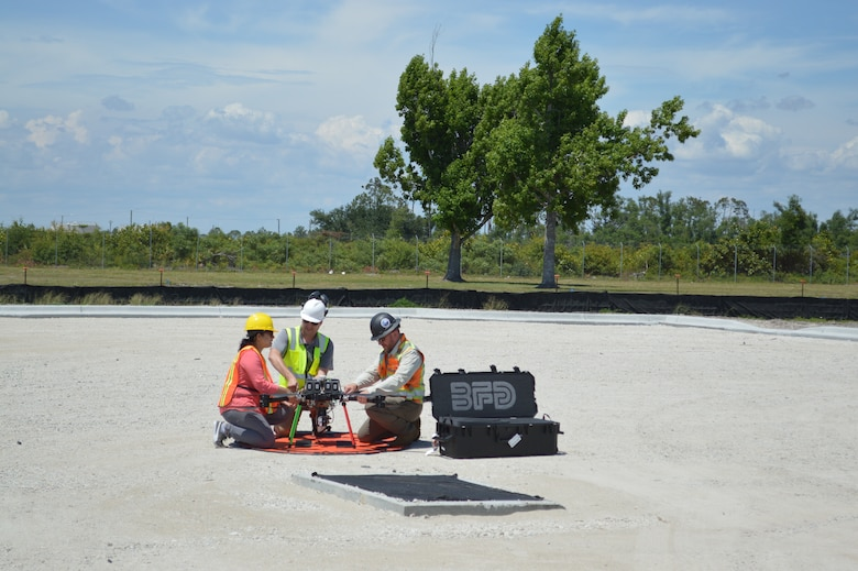 Technicians prepare a drone for flight at Tyndall Air Force Base, Florida, June 4, 2021. The drone captured data for a Digital Twin replica of the installation. (U.S. Air Force photo by Sarah McNair)