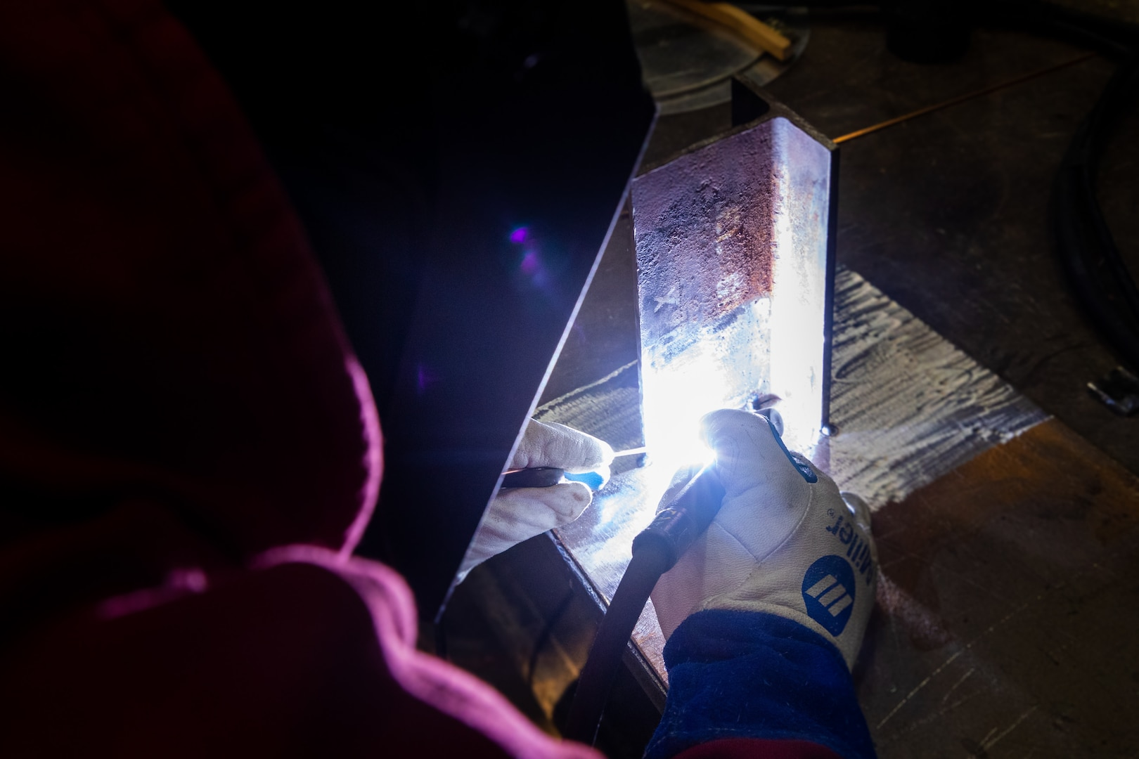 NNSY's Welding Shop (Shop 26) Work Leader Todd Scott works on a mock up (SSN 752).  RIGHT: Shop 26 Work Leader Jeffrey Hamlin welds a carbon steel foundation.