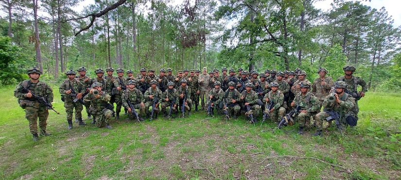 U.S. Army Maj. Gen. Daniel R. Walrath, center-right, commanding general, U.S. Army South, and Colombian Army Maj. Gen. German Lopez Guererro, center-left, Colombian Army Force Generation chief of staff, visit with troops participating in a combined combat training event at the Joint Readiness Training Center, Fort Polk, La., June 9.   A platoon from the Colombian Army's Counter Narcotics Brigade is participating in JRTC Rotation 21-08 with members of the U.S. Army South Carolina National Guard's 1-118th Infantry Battalion to improve interoperability between the U.S. and Colombian armies. The Colombian Army is one of the most professional armies in South America. This opportunity enhances the capabilities and readiness of the U.S. and Colombian Army forces as we continue to develop our mutual readiness.