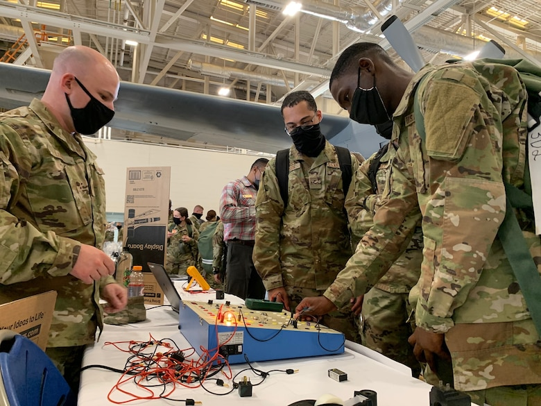 Airmen checking out an electronics display at 37th TRG Showcase.