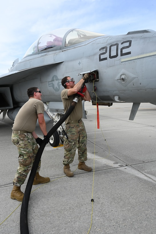 119th Aircraft Maintenance Squadron members refuel a VFA F/A-18 Super Hornet from Naval Air Station Oceana, Va., upon its arrival to participate in Exercise Victory Hooligan at the North Dakota Air National Guard Base, Fargo, N.D., June 7, 2021. (U.S. Air National Guard photo by Chief Master Sgt. David H Lipp)
