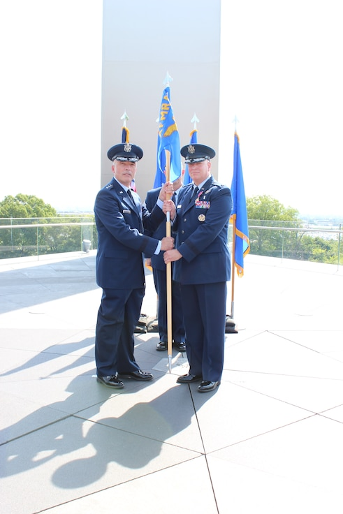 Image of two Airmen holding a guidon.