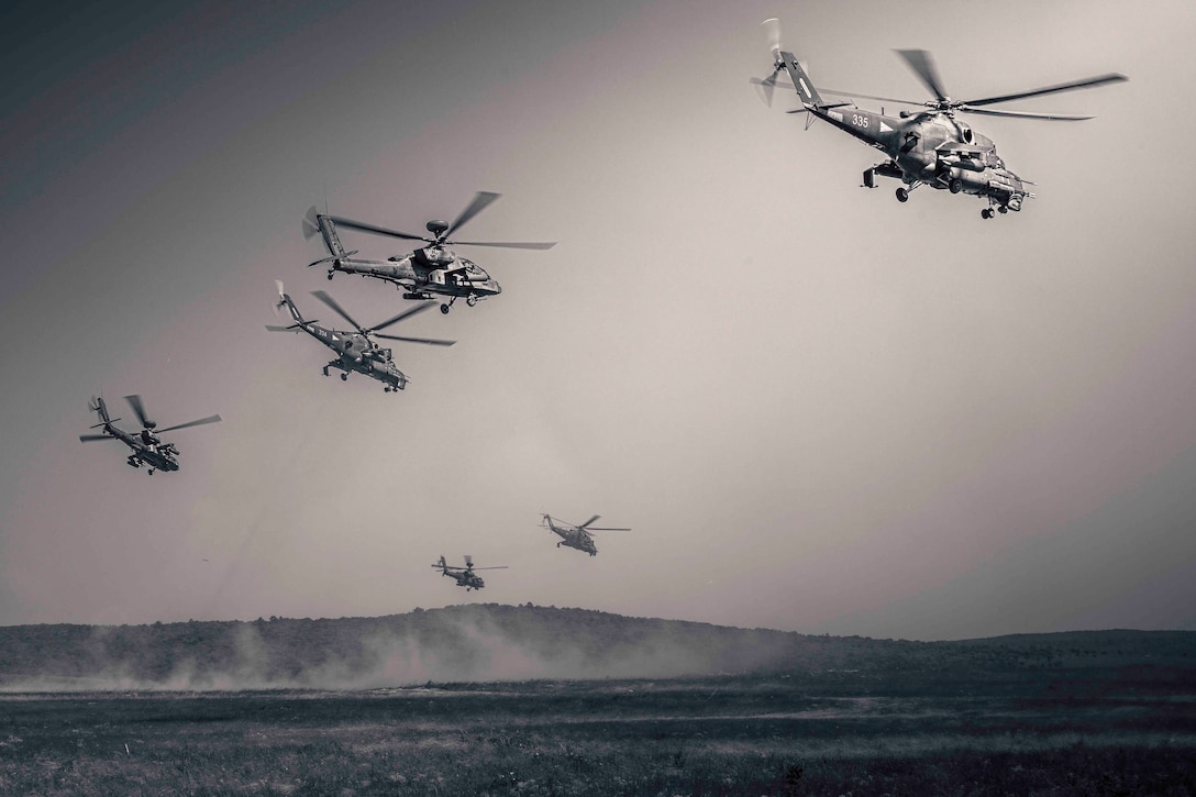 Six helicopters fly in formation.