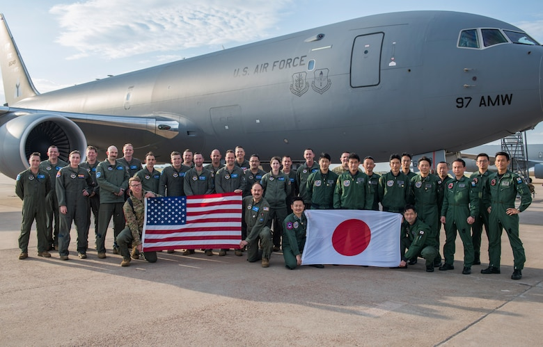 U.S. Air Force Airmen from the 56th Air Refueling Squadron and Japanese aircrew students pose for a photo in front of a KC-46 Pegasus, May 12, 2021, at Altus Air Force Base, Oklahoma. The students are the first U.S. allies to train on the KC-46. (U.S. Air Force photo by Airman 1st Class Amanda Lovelace)
