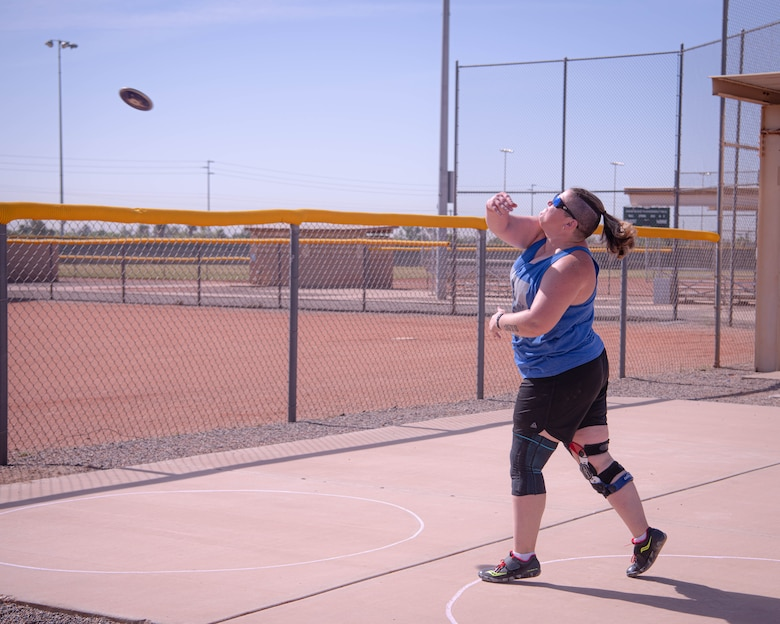 Retired U.S. Marine Staff Sgt. Beth Grauer throws a discus during the Desert Challenge Track and Field Training Camp May 25, 2021, at Luke Air Force Base, Arizona.