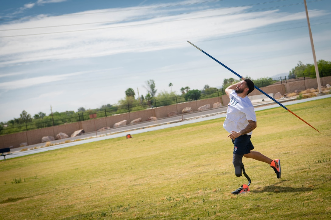 Retired U.S. Army Sgt. Michael Gallardo throws a javelin during the Desert Challenge Track and Field Training Camp May 26, 2021, at Luke Air Force Base, Arizona.