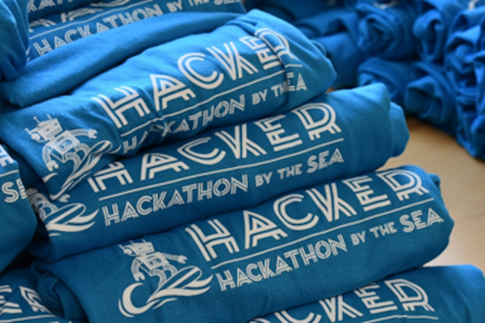 """Students participating in the 2021 Hackathon by the Sea competition received a shirt to commemorate the two-day event hosted by NSWC PHD, Naval Air Warfare Center Weapons Division, and Naval Facilities Engineering and Expeditionary Warfare Center, in partnership with the Ventura County Office of Education. The theme this year was """"Hack The Future."""