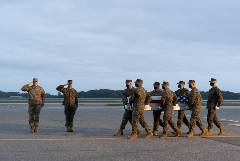 A U.S. Marine Corps carry team transfers the remains of Marine Cpl. Brandon J. Alvarez of Newbury Park, California, June 10, 2021 at Dover Air Force Base, Delaware. Alvarez was assigned to FAST Co., Central Marine Corps Security Force Regiment, Bahrain. (U.S. Air Force photo by Jason Minto)