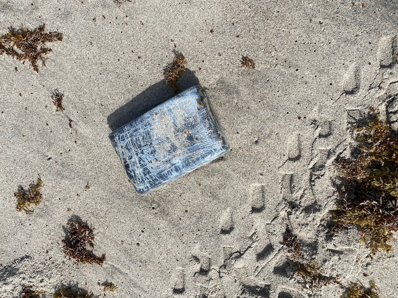 Defenders from the 45th Security Forces Squadron seize nearly 30 kilograms of cocaine that washed ashore on a Cape Canaveral Space Force Station, Florida, beach, May 19, 2021. According to the Brevard County Sheriff's Office, the drugs had an estimated value of approximately $1.2 million.