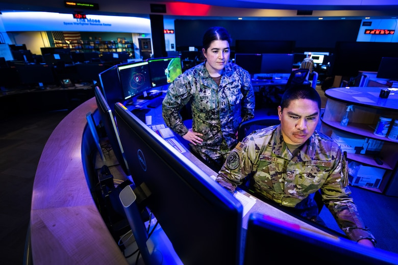 Joint members work at the National Space Defense Center.