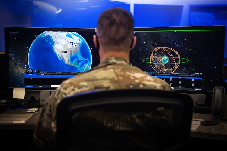 Member looks at space domain imagery in the National Space Defense Center.