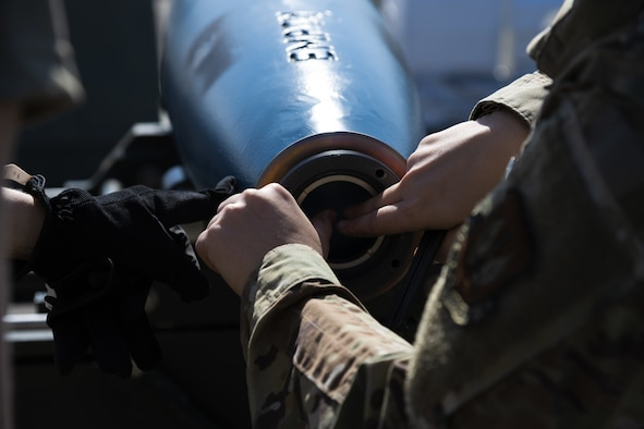 U.S. Air Force Capt. Jacqueline Pippin, 52nd Fighter Wing chaplain, helps assemble a GBU-12 inert bomb used for training at Kallax Air Base, Sweden, June 7, 2021. During training exercises like the Arctic Challenge Exercise 2021, Participation in multinational exercises like Arctic Challenge 21 enhances our professional relationships and improves overall coordination with allies and partner militaries during times of crisis. (U.S. Air Force photo by Senior Airman Ali Stewart)