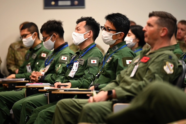 Service members from U.S. Air Force and Japan Self-Air Defense Force listen to the Deployed Forces Commander, Col. Brian Cusson, to kick-off RED FLAG-Alaska 21-2 at Joint Base Elmendorf-Richardson, Alaska, June 10, 2021.
