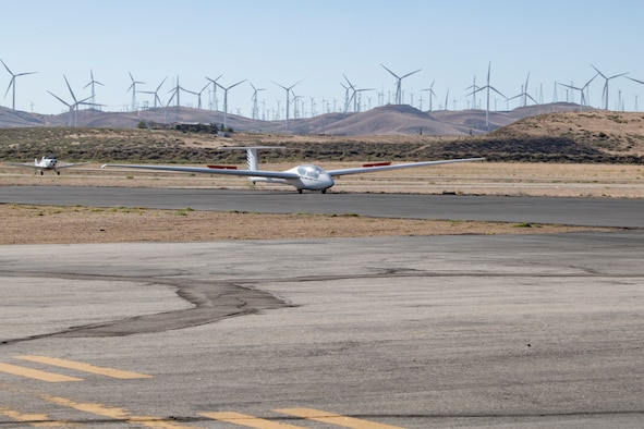 Glider being towed by a plane.